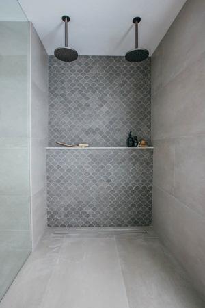 bathroom renovation with dual head design shower with avocado constructions brisbane