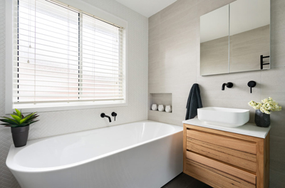 free standing bath, timber vanity and black tapware tips from Avocado Constructions Brisbane