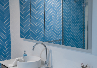 herringbone tile feature wall in belmont bathroom renovation with Avocado Constructions