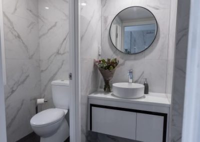 marble powder room in calamvale with Avocado Constructions
