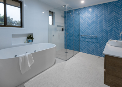 spa bath main bathroom renovation with Avocado Constructions