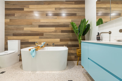 coastal bathroom renovation with timber feature wall by avocado constructions