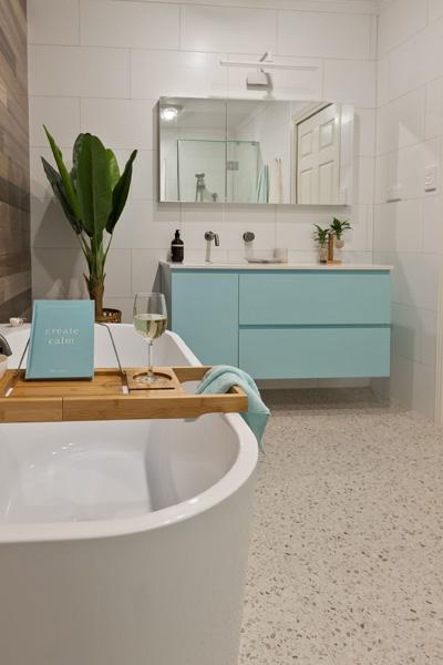 main bathroom renovation showcasing a feature wall by avocado constructions arana hills