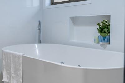 belmont bathroom spa bath renovation gooseneck floor mounted tapware by avocado constructions