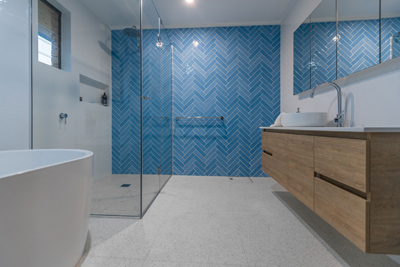 belmont master bathroom renovation bue herringbone feature wall by avocado constructions